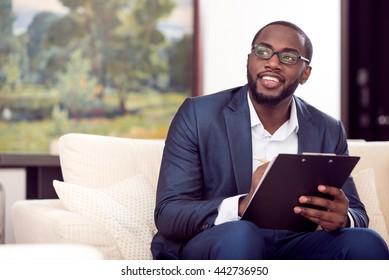 Afro American man taking notes