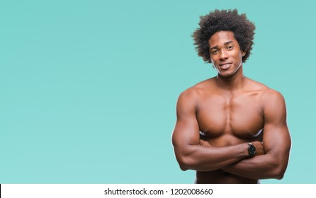 Afro american shirtless man showing nude body over isolated background happy face smiling with crossed arms looking at the camera. Positive person.