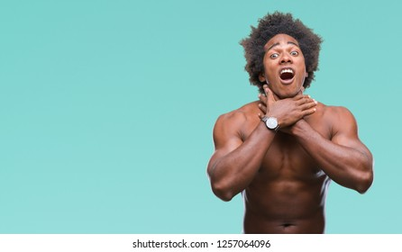 Afro american shirtless man showing nude body over isolated background shouting and suffocate because painful strangle. Health problem. Asphyxiate and suicide concept.