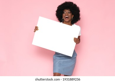 Afro american woman holding a white banner.