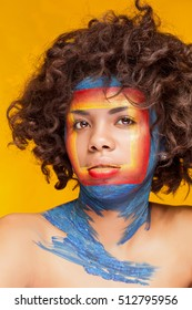 Afro american woman with square on face on yellow background. Beauty make up