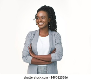 Afro Business Lady Posing Crossing Hands Looking Aside Isolated Over White Studio Background. Free Space