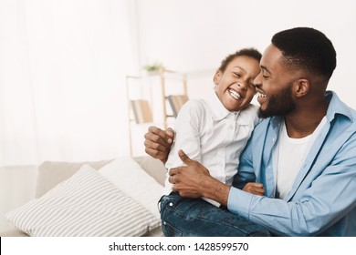 Afro Father Tickling Daughter, Having Fun And Playing Together At Home
