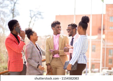 afro guests are waiting for a bride and a groom in the street with modern buildings.