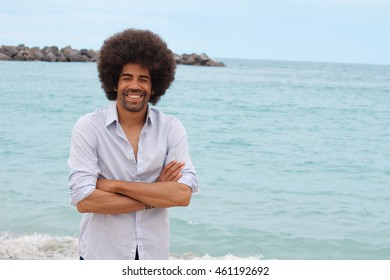 afro man on beach stock photo royalty free 461179849 shutterstock