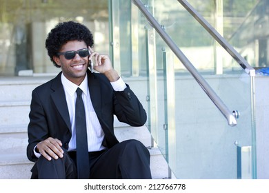 afro man talking on the phone