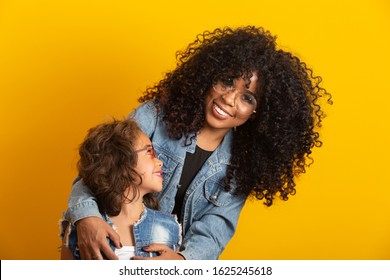 Afro mother and daughter with their glasses. Mother's day concept