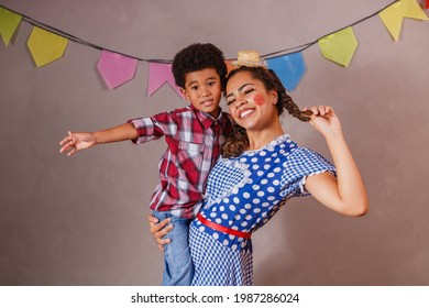 Afro mother and son dressed for June party