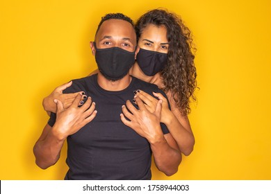 Afro valentine couple with mask on yellow background. Covid-19