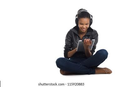 Afro woman listening music.