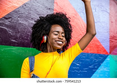 Afro woman listening to music