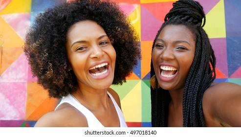 Afro women taking selfie photos in the park