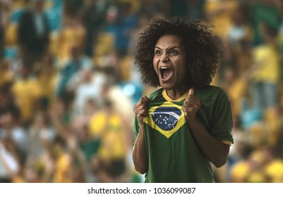 Afro young Brazilian woman fan celebrating