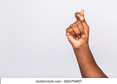 Afro-American black man's hand showing different gestures on white background, closeup view of hands.