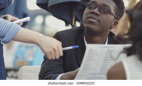 Afro-american business people ordering food and drinks in cafe