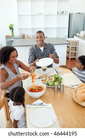 Afro-american family dining together in the kitchen