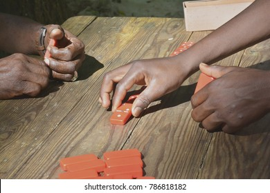 Afroamerican hands playing domino