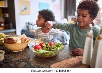 afro-american kids eating healthy food together. brother and sister. togetherness concept, sharing meal