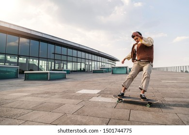 Afro-american man makes turn on his skateboard