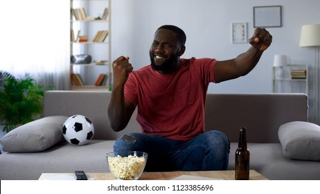 Afro-american man satisfied with victory of sports team at national competition