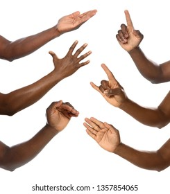 Afro-American man showing different gestures on white background, closeup view of hands