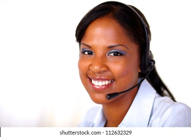 Afro-american receptionist looking at you with headphones - copyspace