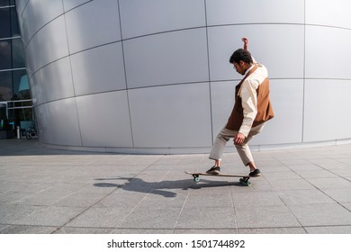 Afro-american skateboarder makes stunt in summer day