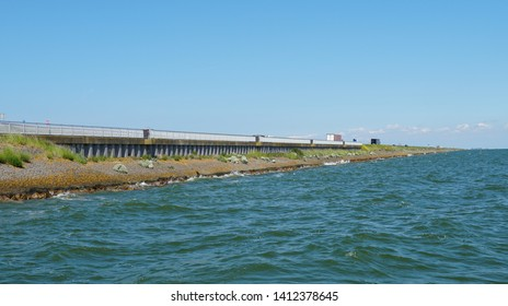 The afsluitdijk (English: enclosure dam) in the Netherlands, a major dam and causeway that separates the North Sea from the Ijsselmeer lake.