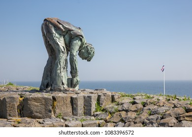 Afsluitdijk, The Netherlands - April 20, 2018: Statue of worker at Afsluitdijk. This is the separation of the salt Wadden Sea and the fresh water lake IJsselmeer