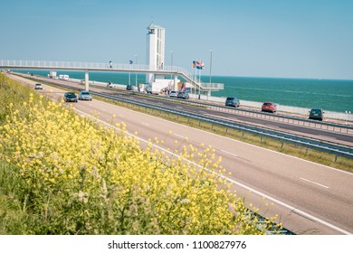 Afsluitdijk Netherlands May 2018, monument with tower of the biggest dike in the Netherlands on a bright summer day with traffic road