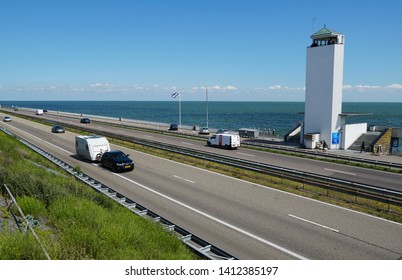 Afsluitdijk, the Netherlands. May 2019. The afsluitdijk (English: enclosure dam) in the Netherlands, a major dam and causeway that separates the North Sea from the Ijsselmeer lake.