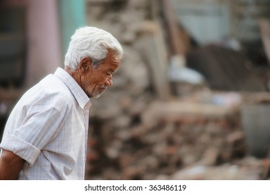 After 2 weeks of large 2015 great earthquake in Nepal, this old man is walking over the rubble. His feeling at that time was hard to explain.