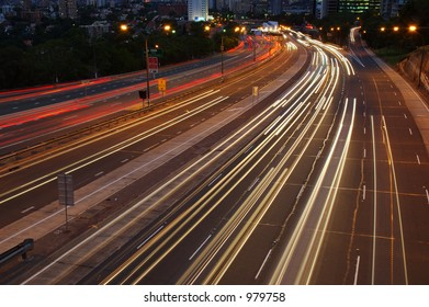 After Dark. Cars traveling on a motorway at night.