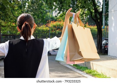 After day for shopping,women with   shopping bags on the holding hand.
