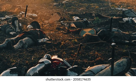 After Epic Battle Bodies of Dead and Murdered Medieval Knights Lying on Battlefield. Warrior Soldiers Fallen in Conflict, War, Conquest. Cinematic Dramatic Historical Reenactment.