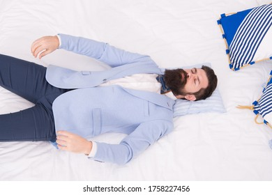 After groom party. Groom sleep in bed. Bearded man in groom wear. Bachelor or fiance. Husband or newlywed. Wedding attire. Menswear shop. Formalwear and party wear. Fashion and style for groom.
