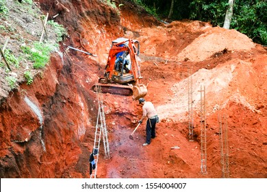 After heavy rains cause landslides to damage the road. Workers under construction after a landslide.
