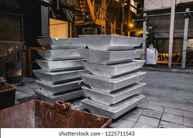 After melting, large volumes of aluminum ingots cool down before shipment to sale. Business concept of commodity and state sectoral policies.