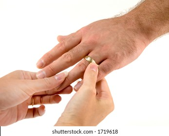 After placing the wedding band on his bride's ring finger, it is the groom's turn.