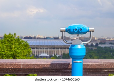 After the rain, blue stationary binoculars on the observation deck of the Sparrow hills