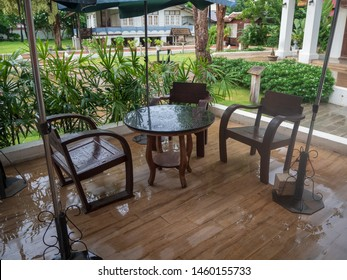 After the rain, wet tables and cafe chairs on the coffee shop at Nan, Thailand