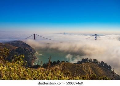 After Sunrise in Golden Gate Bridge, blue sky and fog from Hawk Hill, San Francisco, California, USA