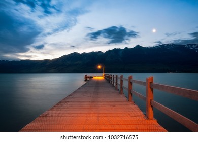 After sunset, the moon is rising at Glenorchy Warf. Glenorchy is a charming touristic village situated at the Northern end of Lake Wakatipu, otago Region, New Zealand South Island.
