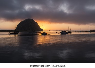 After sunset view of small boats resting in scenic Morro Bay, California.