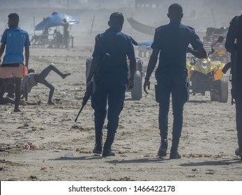After a troubled time on the beach in Accra, heavily armed police patrol the beach one hazy afternoon. Labadi beach Accra Ghana 2018 April 16