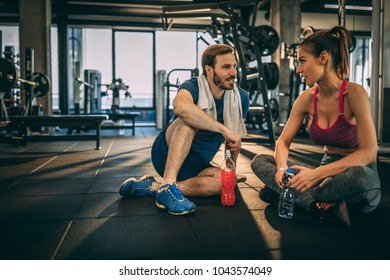 After the workout is time for little chat. Fitness couple in the gym.