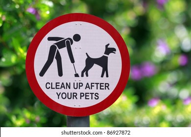 """Clean up after your pets"" sign at the park"