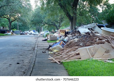 The aftermath of Hurricane Harvey: many flooded houses, owners throw away their belongings, materials that were under water. The streets are huge piles of garbage. Houston, Texas, US
