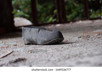 Aftermath war - single torn shoe galosh in a ruined building in Abhazia