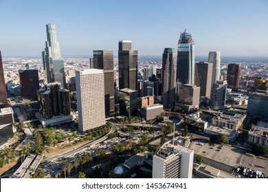 Afternoon aerial of freeway, streets, towers and buildings in sprawling downtown Los Angeles, California.